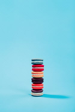 Magdalena Russocka pile of colorful macaroons on pastel blue background
