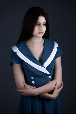 Magdalena Russocka teenage girl wearing blue dress inside