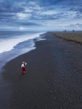 Mary Wethey EDWARDIAN WOMAN ON BEACH WITH LONG COASTLINE