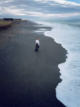 Mary Wethey HISTORICAL WOMAN ON BEACH WITH BLACK SAND