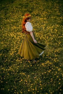 Rebecca Stice WOMAN WITH RED HAIR IN FIELD OF YELLOW FLOWERS