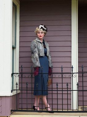 Elisabeth Ansley SERIOUS BLONDE RETRO WOMAN OUTSIDE HOUSE