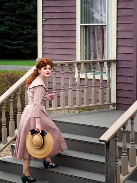 Elisabeth Ansley RETRO WOMAN WITH RED HAIR ON STEPS OF HOUSE