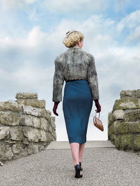 Elisabeth Ansley BLONDE RETRO WOMAN WALKING OVER BRIDGE