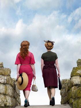 Elisabeth Ansley TWO RETRO WOMEN WALKING OVER BRIDGE