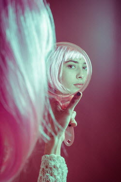 Esme Mai WOMAN WITH SILVER HAIR REFLECTED IN MIRROR