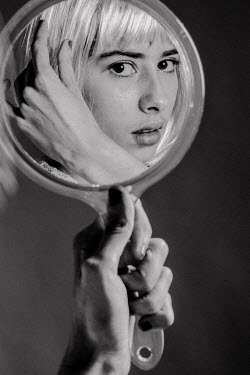 Esme Mai WOMAN WITH WHITE HAIR REFLECTED IN MIRROR