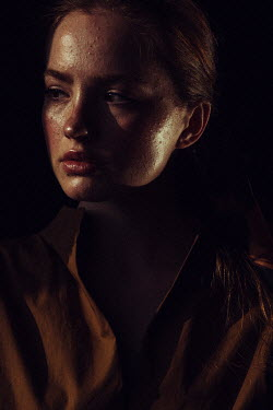 Marta Syrko SERIOUS WOMAN WITH BROWN HAIR IN SHADOW