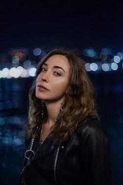 Tatiana Mertsalova BRUNETTE WOMAN IN LEATHER JACKET AT NIGHT