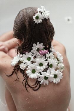 Tatiana Mertsalova WOMAN IN BATH WITH FLOWERS IN HAIR