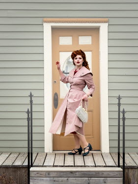 Elisabeth Ansley RETRO WOMAN WITH RED HAIR OUTSIDE HOUSE