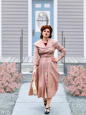 Elisabeth Ansley RETRO WOMAN WITH RED HAIR LEAVING HOUSE