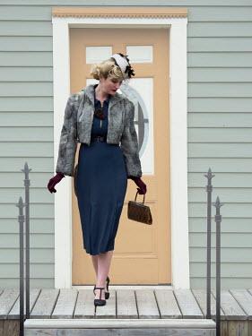 Elisabeth Ansley RETRO WOMAN BLONDE HAIR OUTSIDE HOUSE