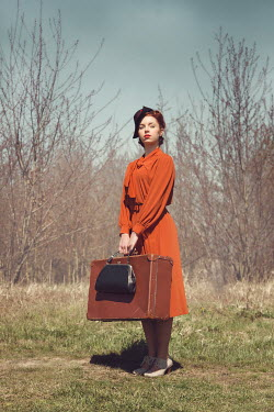 Joanna Czogala RETRO WOMAN WITH SUITCASE IN COUNTRYSIDE