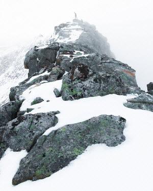 Paul Sheen MAN STANDING ON TOP OF SNOWY MOUNTAIN