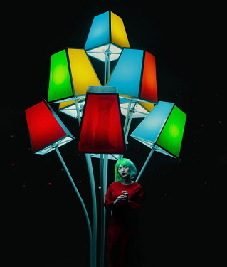 Svitozar Bilorusov WOMAN STANDING BELOW COLOURED LIGHTS OUTDOORS
