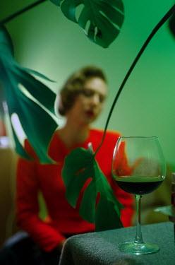 Svitozar Bilorusov BLONDE RETRO WOMAN WITH DRINK INDOORS