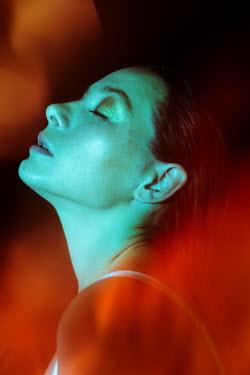 Tatiana Mertsalova PROFILE OF DAYDREAMING WOMAN WITH ORANGE LIGHT