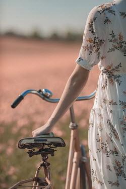 Ildiko Neer Close up of woman holding bike