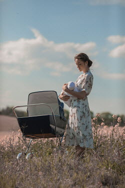 Ildiko Neer woman with baby and pram in countryside
