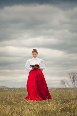 Joanna Czogala HISTORICAL WOMAN READING BOOK IN COUNTRYSIDE