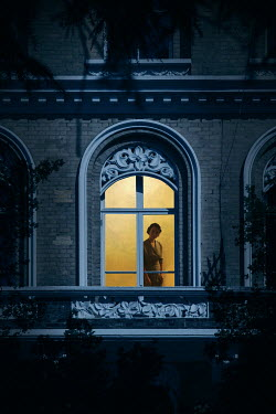Miguel Sobreira RETRO WOMAN INDOORS BY WINDOW AT NIGHT