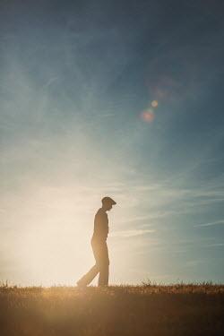 Magdalena Russocka retro man walking in field at sunset