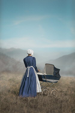 Ildiko Neer Amish woman with pram countryside