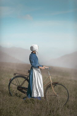 Ildiko Neer Amish woman with bicycle countryside