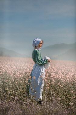 Ildiko Neer Historical woman holding baby countryside