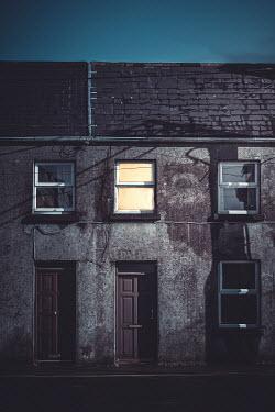 Marie Carr LIGHT IN BEDROOM WINDOW OF TERRACED HOUSE