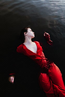 Matilda Delves WOMAN IN RED DRESS FLOATING IN WATER