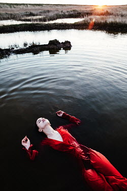 Matilda Delves WOMAN WITH RED DRESS FLOATING IN WATER