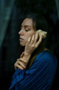 Svitozar Bilorusov DAYDREAMING GIRL LISTENING TO SEA SHELL