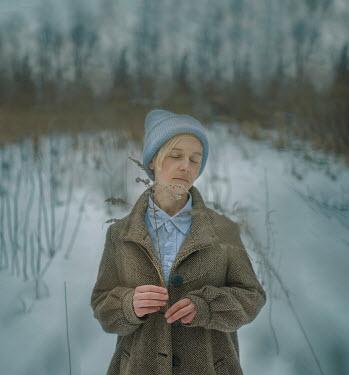 Svitozar Bilorusov DAYDREAMING GIRL WITH BLONDE HAIR IN SNOWY FIELD