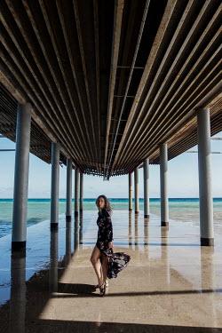 Tatiana Mertsalova WOMAN IN DRESS BY SEA UNDERNEATH PIER