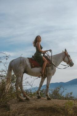 Tatiana Mertsalova BRUNETTE WOMAN ON HORSE IN COUNTRYSIDE
