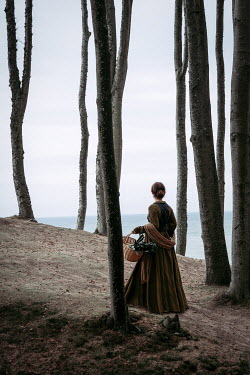 Natasza Fiedotjew historic woman in bare tree forest