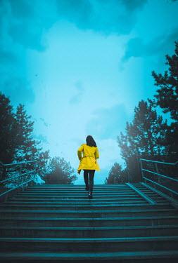 Joanna Czogala WOMAN RUNNING UP URBAN STEPS AT DUSK