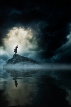 Nic Skerten MAN WITH SWORD ON ROCK IN SEA