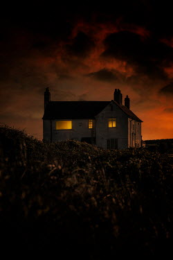 Nic Skerten LIGHTS IN HOUSE IN COUNTRYSIDE AT SUNSET