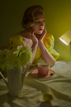 Svitozar Bilorusov BLONDE RETRO WOMAN SITTING INDOORS WITH DRINK
