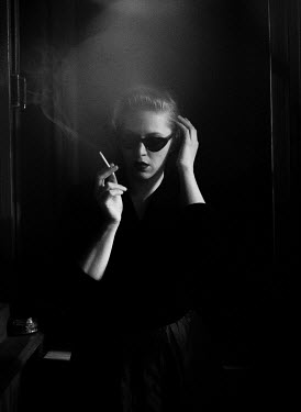 Svitozar Bilorusov RETRO WOMAN WITH SUNGLASSES SMOKING