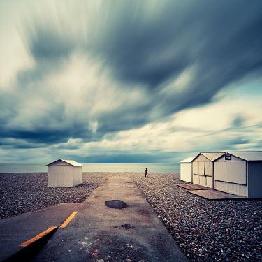 David Keochkerian MAN WATCHING SEA WITH BEACH HUTS