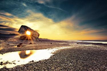 David Keochkerian ABANDONED WAR BUNKER ON BEACH AT SUNSET