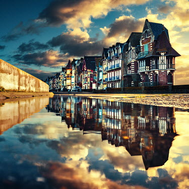 David Keochkerian ROW OF HOUSES REFLECTED IN PUDDLE