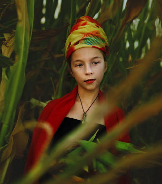 Svitozar Bilorusov YOUNG GIRL IN TURBAN BY LARGE PLANTS
