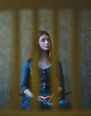 Svitozar Bilorusov SERIOUS GIRL SITTING ON CHAIR INDOORS