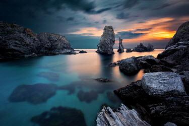 David Keochkerian CALM SEA WITH ROCKS AT SUNSET