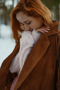 Tatiana Mertsalova SAD WOMAN WITH RED HAIR IN SUEDE JACKET OUTDOORS